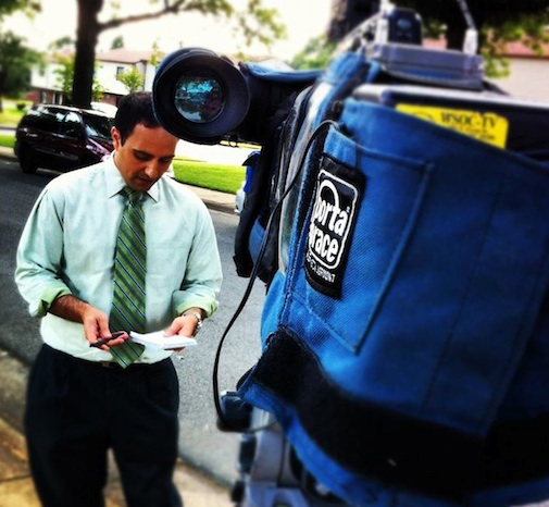Dan preparing for a live report in 2011.